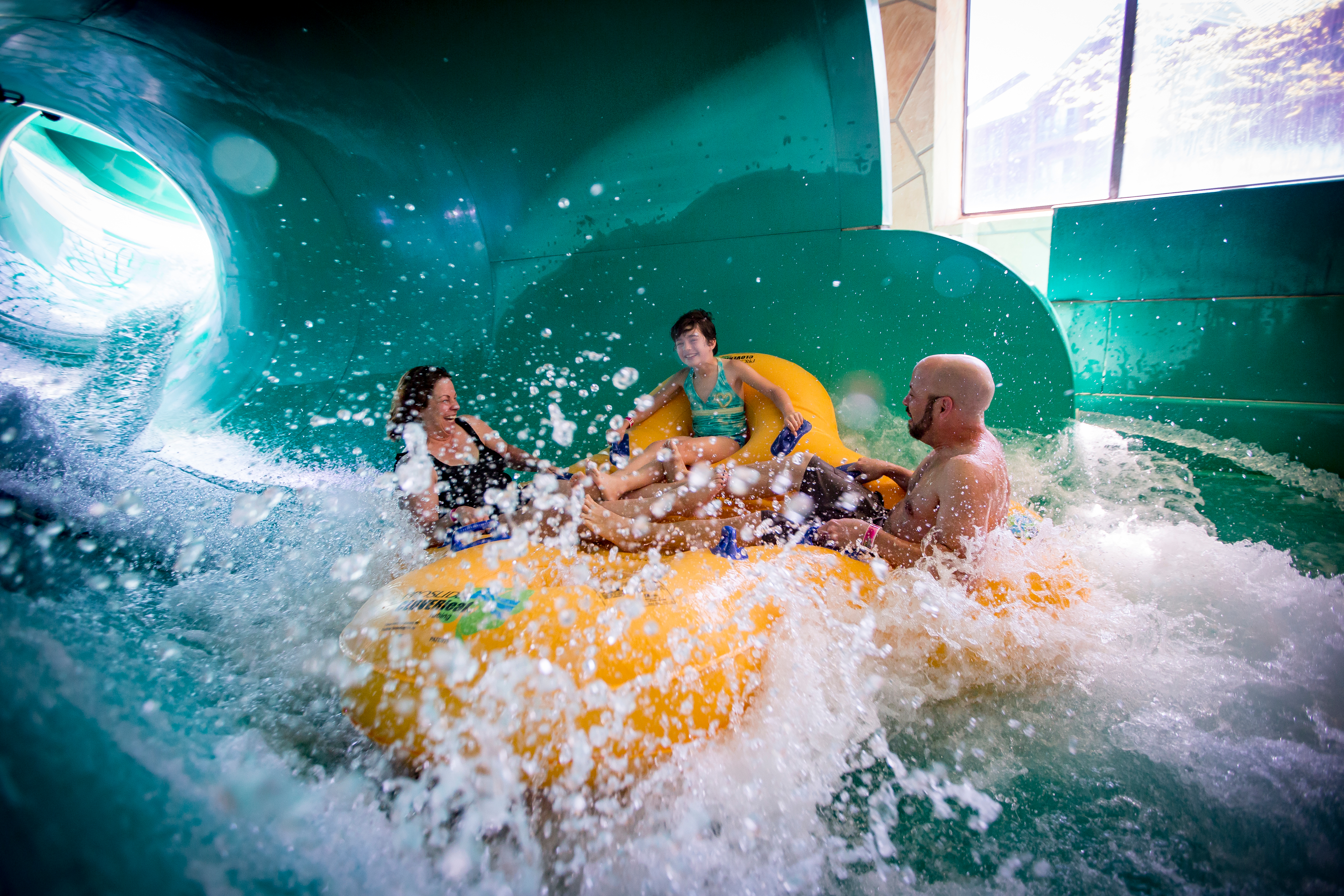 This image has an empty alt attribute; its file name is family-enjoying-the-hurricane-inside-wilderness-waterpark-2.jpg
